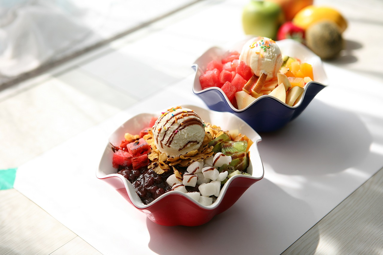 two bowls of korean dessert patbingsu on a table